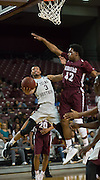 David Blanks of TSU goes up over Quinterian McConion of Alabama A&M. TSU defeats Alabama A&M 77-54 at the HP&E Arena in Houston, Texas. Photo By: Jerome Hicks/ Space City Images