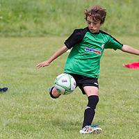 Killian Maduri kicks out the ball during the Avenue Utd Summer Soccer Camp