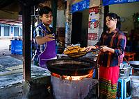 KYAING TONG, MYANMAR - CIRCA DECEMBER 2017:  Merchants close to the morning market in Kyaing Tong preparing breakfast.