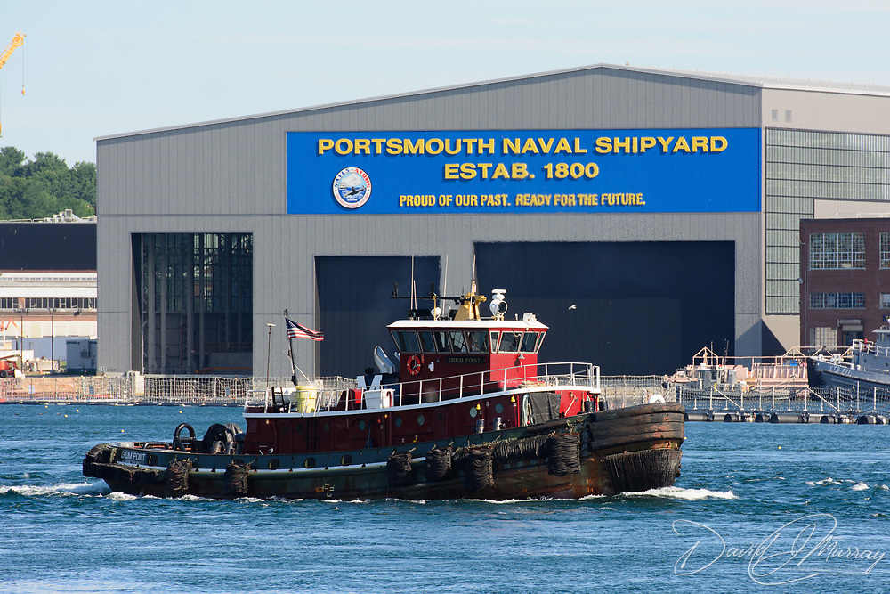 The Drum Point tug boat  sails on  the Piscataqua River near the Portsmouth Naval Shipyard during the Parade of Sail event, August, 2016.