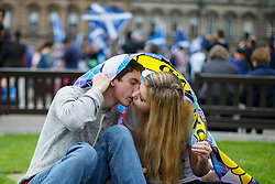 © Licensed to London News Pictures. 18/09/2014. Glasgow, UK. A couple kissing whilst 'Yes' voters and campaigners meeting at George Square in Glasgow as people of Scotland going to polling stations to vote on the Scottish independence referendum on Thursday, 18 September 2014. Photo credit : Tolga Akmen/LNP