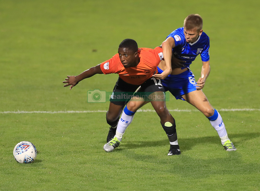 Gillingham's Jake Hessenthaler (right) and Southend United's Amadou Ba (left) battle for the ball