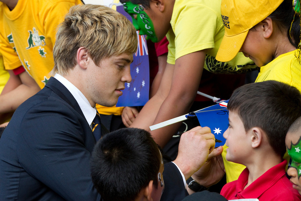 Wing James O'Connor sign autographs as Australia's Rugby World Cup Team arrive at the international airport, Auckland, New Zealand, Tuesday, September 06, 2011.  Credit:SNPA / David Rowland