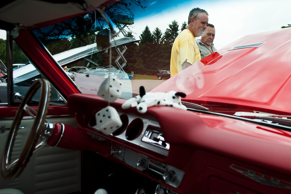 Lathan Goumas | MLive.com..Rob Spaly(in yellow), of Grand Blanc, and Larry Eaton(in green), of Flushing, judge a 1964 Pontiac GTO during the Shriner's 9th Annual Classic Car Show on Sunday in Clio.