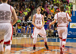 Poca guard Luke Frampton (14) celebrates at mid court against Westside during a semi-final game at the Charleston Civic Center.