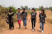 A group of the ICS volunteers walking down the road  in the village of in Banteay Char, near Battambang, Cambodia.