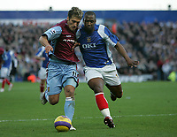 Photo: Lee Earle.<br /> Portsmouth v Aston Villa. The Barclays Premiership. 02/12/2006. Villa's Stiliyan Petrov (L) battles with Noe Pamarot.