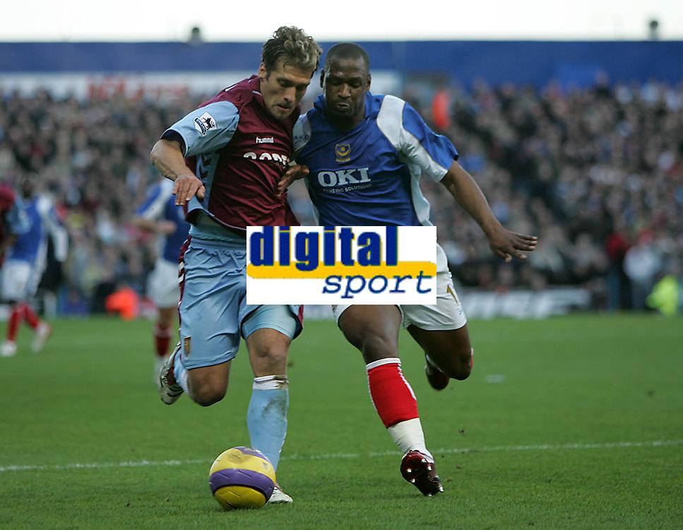 Photo: Lee Earle.<br /> Portsmouth v Aston Villa. The Barclays Premiership. 02/12/2006. Villa's Stiliyan Petrov (L) battles with Noe Pamarot.