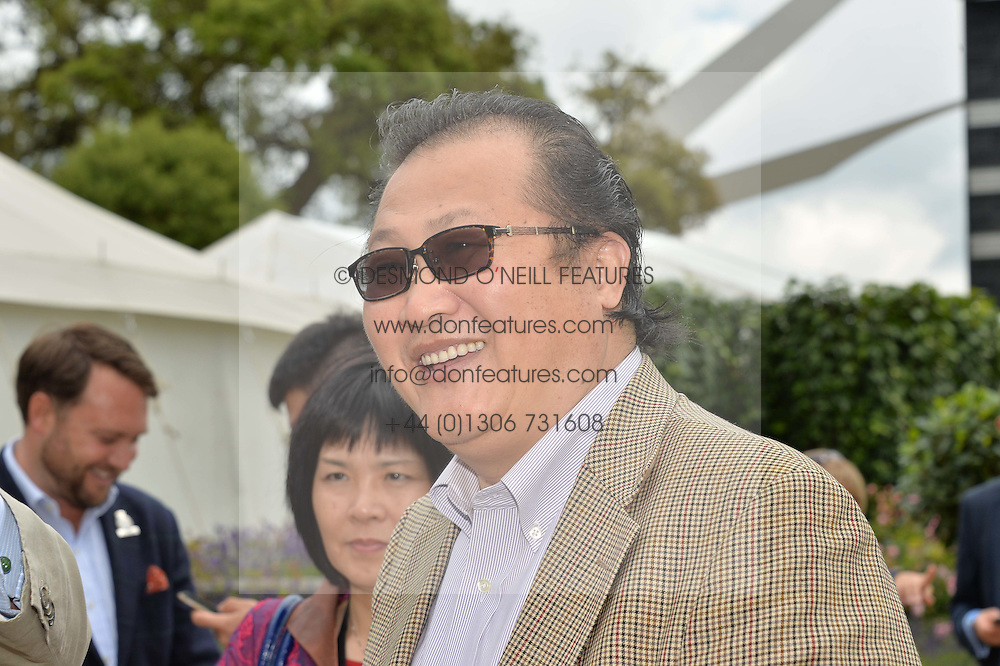 Jin Xu, Minister Counsellor of the Economic and. Commercial Office of the Chinese Embassy in the UK at the Cartier hosted Style et Lux at The Goodwood Festival of Speed at Goodwood House, West Sussex on 26th June 2016.