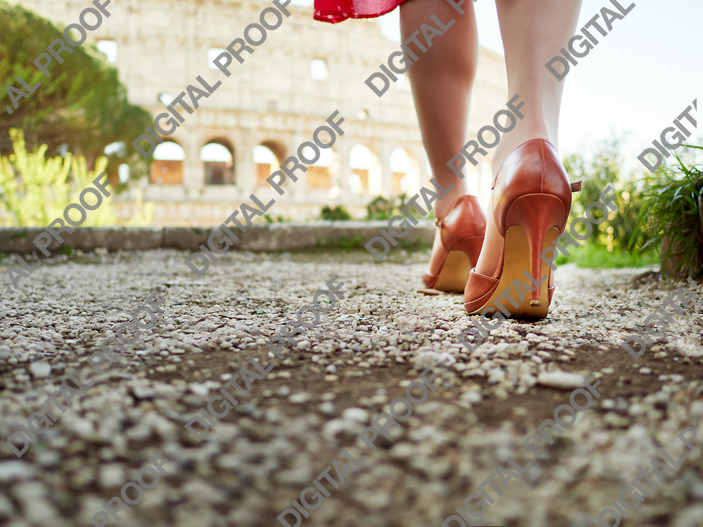 Detail High heels walking towards the colosseum in Rome Italy
