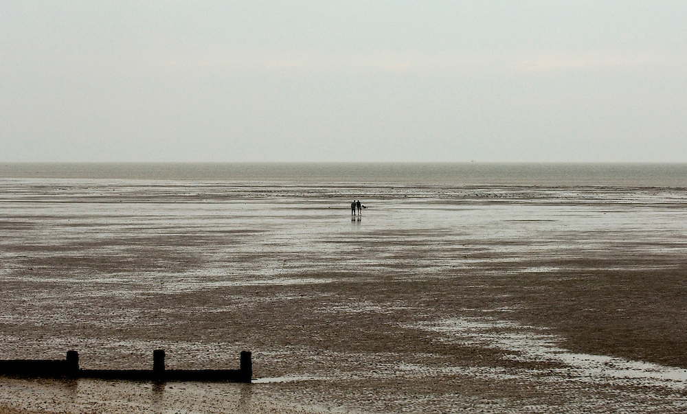 Walking on the beach at low tide, Isle of Sheppey, Kent