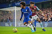 Chelsea midfielder Willian (10) and Aston Villa defender Tyrone Mings (40) during the Premier League match between Chelsea and Aston Villa at Stamford Bridge, London, England on 4 December 2019.