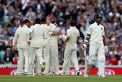 India's Shikhar Dhawan walks of the field after been dismissed for an lbw by England's Stuart Broad during the test match at The Kia Oval, London.