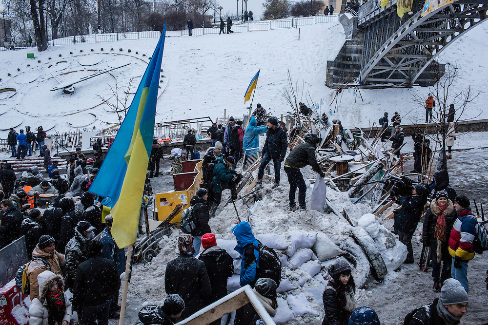 KIEV, UKRAINE - DECEMBER 11: Anti-government protesters use snow to reinforce a barricade blocking street access to Independence Square, known as the Euromaidan, on December 11, 2013 in Kiev, Ukraine. Thousands of people have been protesting against the government since a decision by Ukrainian president Viktor Yanukovych to suspend a trade and partnership agreement with the European Union in favor of incentives from Russia. (Photo by Brendan Hoffman/Getty Images) *** Local Caption ***