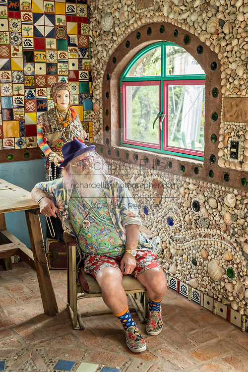 American artist Anado McLauchlin relaxes in the Chapel of Jimmy Ray in his art compound Casa las Ranas September 28, 2017 in La Cieneguita, Mexico.