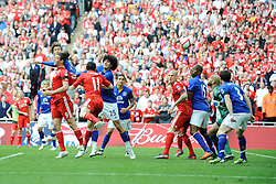 Andy Carroll of Liverpool (left) back-heads to score the winning goal during the Budweiser FA Cup semi final match between Liverpool and Everton at Wembley on Saturday 14 April 2012 (Photo by Rob Munro)