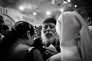 Egypt, Cairo: Father Samaan Ibrahim performs the ritual of exorcism in Deyr el Qiddis Samaan (Monastery of St.Simon) in Manshyet Naser el Moqattam. ph.Christian Minelli..