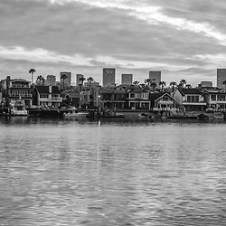 Newport Beach California skyline sunrise black and white panorama photo with Fashion Island office buildings, Balboa Island homes, and Newport Harbor. Panorama photo ratio is 1:3. Copyright ⓒ 2017 Paul Velgos with All Rights Reserved.