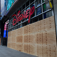 The Disney store in Times Square has boarded up windows in preparation for another expected night of protests due to the killing of George Floyd by a Minnesota Police Officer on Tuesday, June 2, 2020 in Manhattan, New York.  A citywide 8 p.m. curfew was ordered by NY Mayor Bill de Blasio amid the Floyd protests. (Alex Menendez via AP)