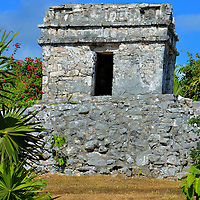 Watch Tower Temple at Mayan Ruins in Tulum, Mexico<br /> Unlike most Mayan sites, the one at Tulum was built like a fort. It was protected by walls that were up to 23 feet thick and 10 to 16 feet tall.  Flanking its western perimeter were two Watch Tower Temples that guarded against intruders by land. This is the tower in the northwest corner called El Torre&oacute;n. Inside of this temple is an altar.