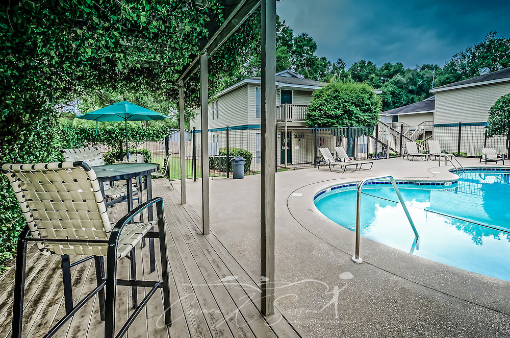 The swimming pool and outdoor seating area is shown at Robinwood Apartments, June 11, 2015, in Mobile, Alabama. The one-bedroom apartments, located on Old Shell Road, are managed by Sealy Realty. (Photo by Carmen K. Sisson/Cloudybright)