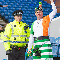 Rangers v Celtic Scottish Premiership 11 March 2018; A Celtic supporter enjoys a chat with a policeman before the Rangers v Celtic Scottish Premiership match played at Ibrox Stadium, Glasgow; <br /> <br /> &copy; Chris McCluskie | SportPix.org.uk