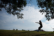 Student photographer Nathan Manley captures a throw on the Kent State disc golf course.