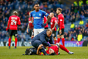 Gary Dicker of Kilmarnock receives treatment during the Ladbrokes Scottish Premiership match between Rangers and Kilmarnock at Ibrox, Glasgow, Scotland on 16 March 2019.