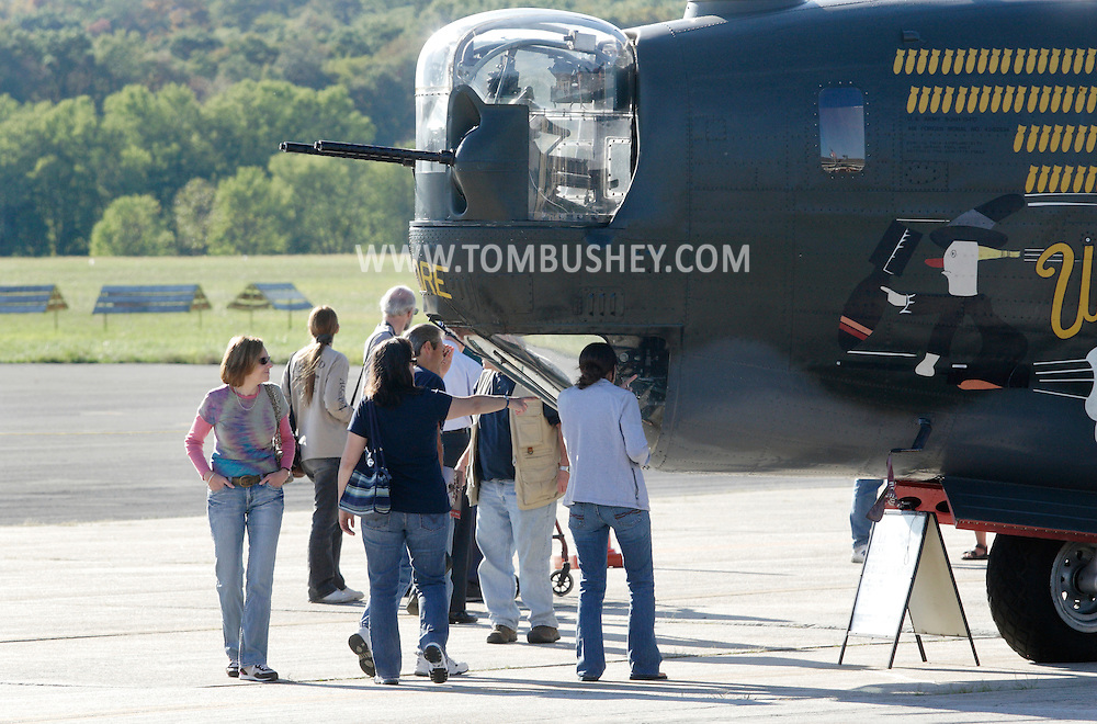 Montgomery, New York - People look at a B-24 Liberator bomber from Collings Foundation on display as part of the Wings of Freedom Tour at Orange County Airport on Oct. 2, 2010.