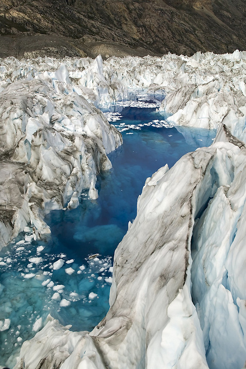 July 2005 GreenlandImage of the Vestfjord Glacier in East Greenalnd taken from a helicopter. The melt water forms in the crevasses of the glacier Pic Steve Morgan
