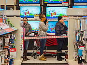 "28 NOVEMBER 2019 - ANKENY, IOWA: Shoppers in line in the electronics department at the Target store in Ankeny, Iowa. ""Black Friday"" is the unofficial start of the Christmas holiday shopping season and has traditionally thought to be one of the busiest shopping days of the year. Brick and mortar retailers, like Target, are facing increased pressure from online retailers this year. Many retailers have started opening on Thanksgiving Day. Target stores across the country opened at 5PM on Thanksgiving to attract shoppers with early ""Black Friday"" specials.  PHOTO BY JACK KURTZ"