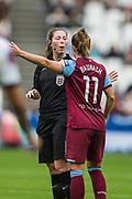 Abigail Bryne (Referee) & Katharina Baunach (West Ham) during the FA Women's Super League match between West Ham United Women and Tottenham Hotspur Women at the London Stadium, London, England on 29 September 2019.