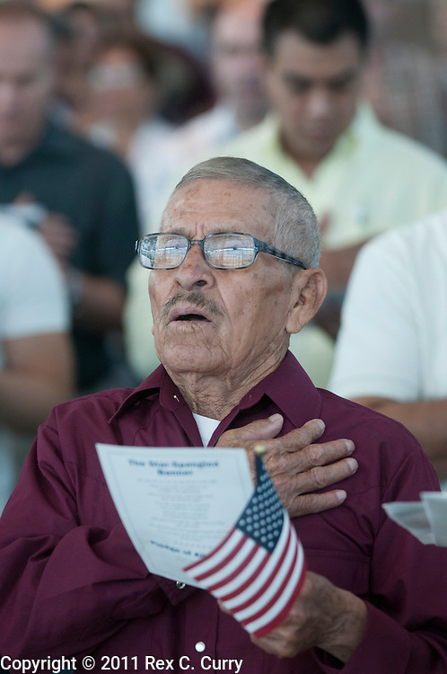 "Francisco Almanza Perez sings along to ""God Bless America"" during a naturalization ceremony at the U.S. Citizenship and Immigration office in Irving on June 30, 2011."