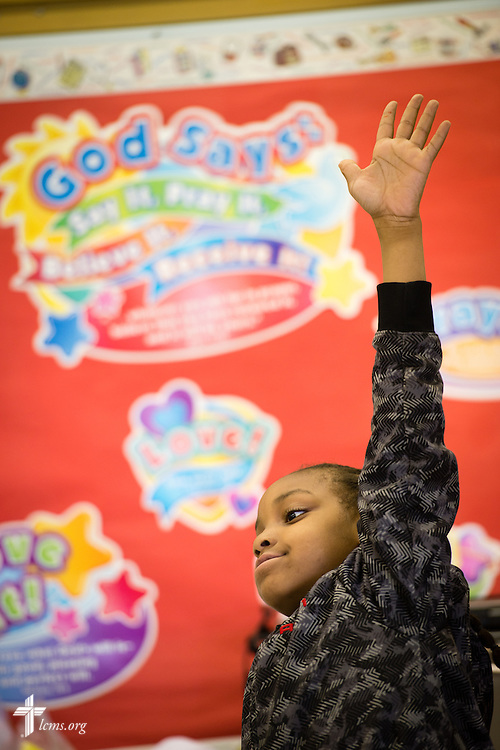 Josiahis Walker raises his hand in class at Lutheran Special School & Education Services, located in Milwaukee Lutheran High School, on Tuesday, May 19, 2015, in Milwaukee, Wis. LCMS Communications/Erik M. Lunsford