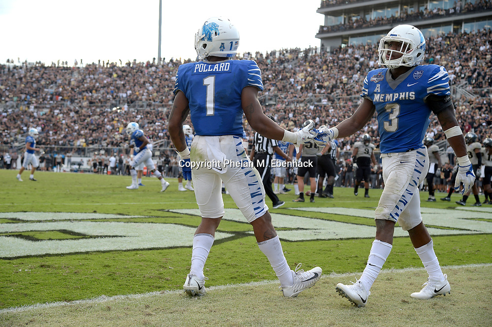 Memphis running back Tony Pollard (1) congratulates wide receiver Anthony Miller (3) after scoring a touchdown during the second half of the American Athletic Conference championship NCAA college football game against Central Florida Saturday, Dec. 2, 2017, in Orlando, Fla. Central Florida won 62-55. (Photo by Phelan M. Ebenhack)
