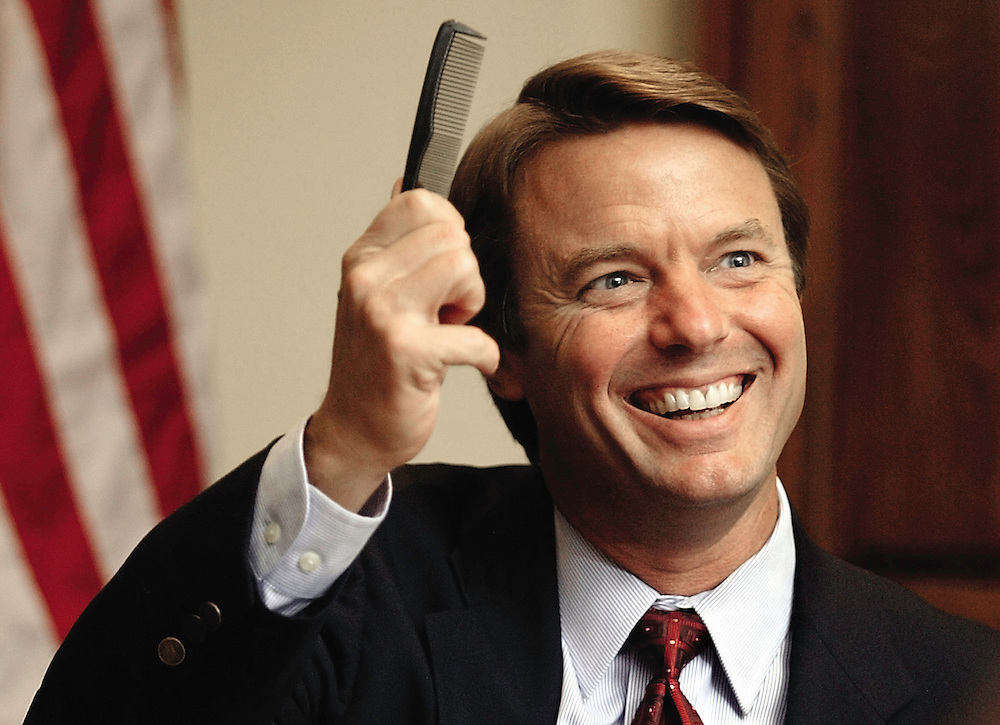 Democratic vice presidential candidate John Edwards shows off his pocket comb to editorial board of the Quad-City Times on Oct. 16, 2004 in Davenport, Iowa, after a reporter inquired about the contents of his pocket.  .