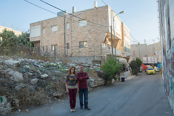 A portrait of Claire Anastas and her husband. Claire's gift shop in Bethlehem is surrounded on three sides by the wall of separation, preventing her doing business with tourists to the Tomb of Rachel, which is on the other side of the wall. From a series of photos commissioned by  British NGO, Medical Aid for Palestinians (MAP).