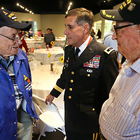 Donald McGovern, a World War II Army Veteran, General T.K Moffett, and Clifton Cockrell, World War II Army Veteran, talk with eachother after the D-Day Luncheon held by the Daily Journal on Thursday. Cockrell, from Mantachie, Served on D-Dayin the Army's 79th Divison, 315th Infantry, 43-47.