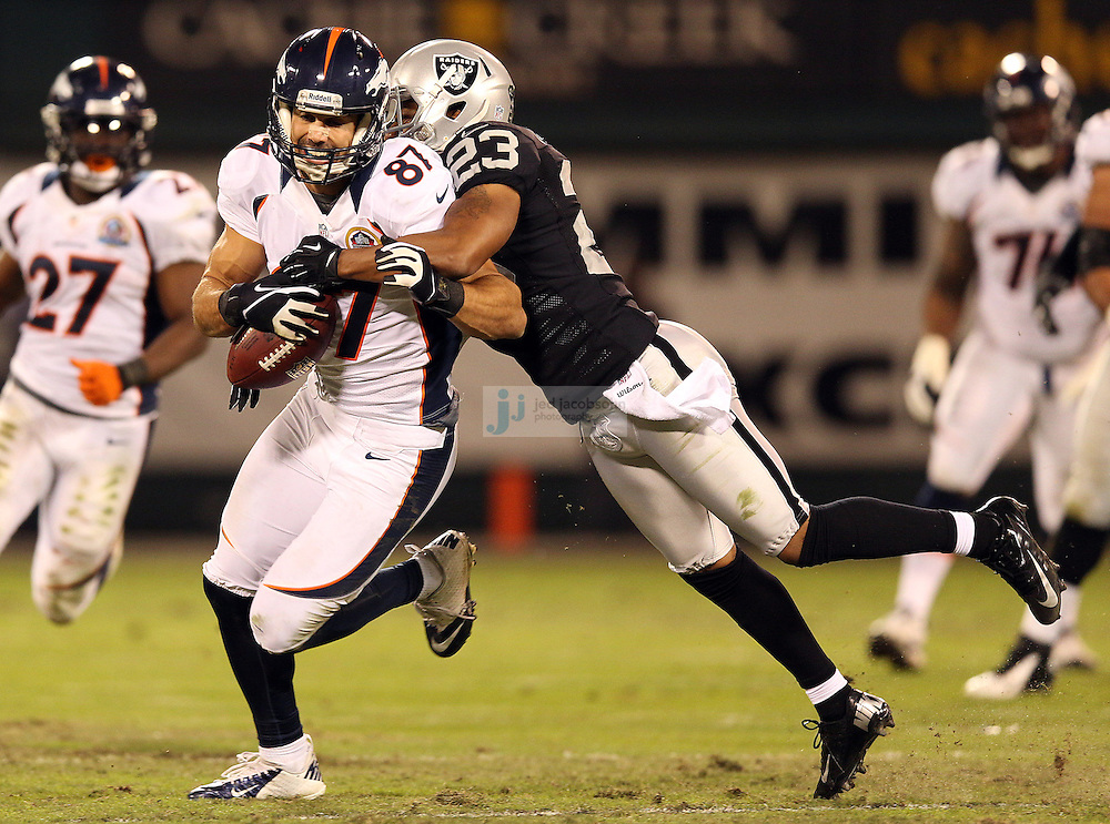 Denver Broncos wide receiver Eric Decker (87) in action against Oakland Raiders cornerback Joselio Hanson (23) during an NFL game on Sunday, December 6, 2012 at the Oakland Coliseum in Oakland, Ca.  (photo by Jed Jacobsohn)