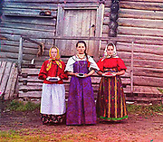 What Russian Empire Looked Like Before 1917… In Color<br /> <br /> The Sergei Mikhailovich Prokudin-Gorskii Collection features colour photographic surveys of the vast Russian Empire made between ca. 1905 and 1915. Frequent subjects among the 2,607 distinct images include people, religious architecture, historic sites, industry and agriculture, public works construction, scenes along water and railway transportation routes, and views of villages and cities. An active photographer and scientist, Prokudin-Gorskii (1863-1944) undertook most of his ambitious colour documentary project from 1909 to 1915. <br /> <br /> Photo Shows; Sergei Three young women offer berries to visitors to their izba, a traditional wooden house, in a rural area along the Sheksna River, near the town of Kirillov.<br /> ©Library of Congress/Prokudin-Gorskii/Exclusivepix Media