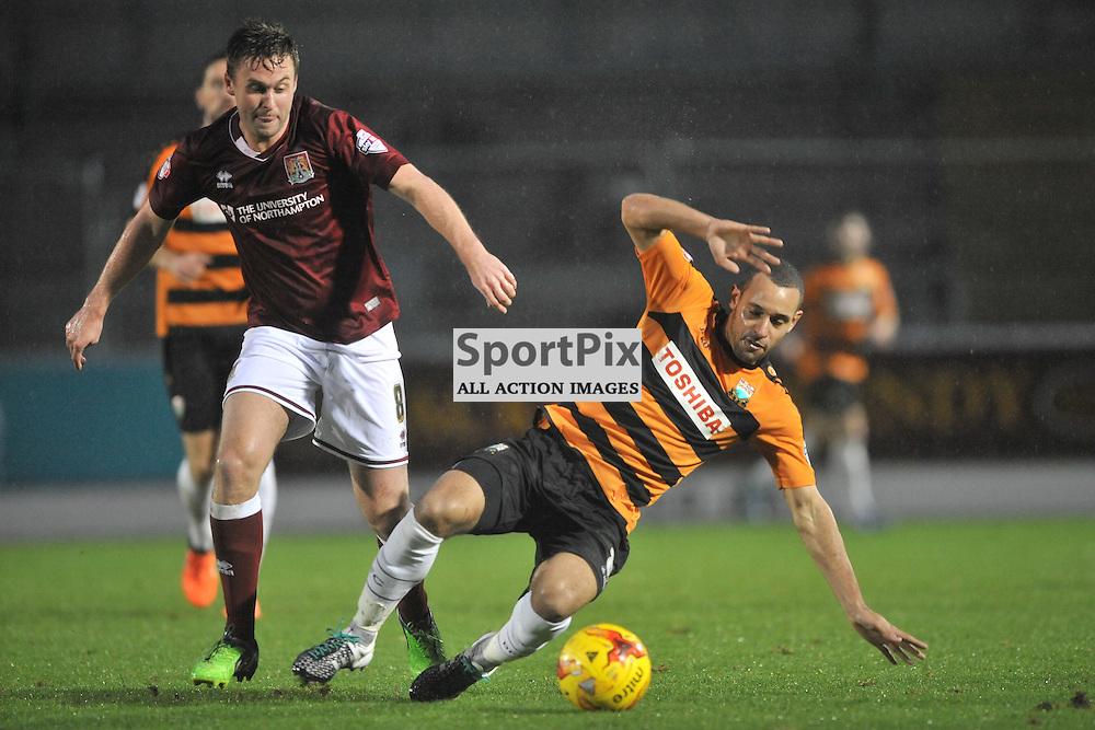 Northamptons Joel Byrom brings Down Barnets Curtis Weston, Northampton Town v Barnet FC, Sixfields Stadium, Sky Bet League Two, Saturday 2nd January 2016