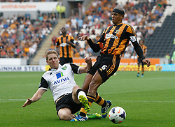 Norwich City's Michael Turner tackles Hull City's Curtis Davies   - Photo mandatory by-line: Matt Bunn/JMP - Tel: Mobile: 07966 386802 24/08/2013 - SPORT - FOOTBALL - KC Stadium - Hull -  Hull City V Norwich City - Barclays Premier League