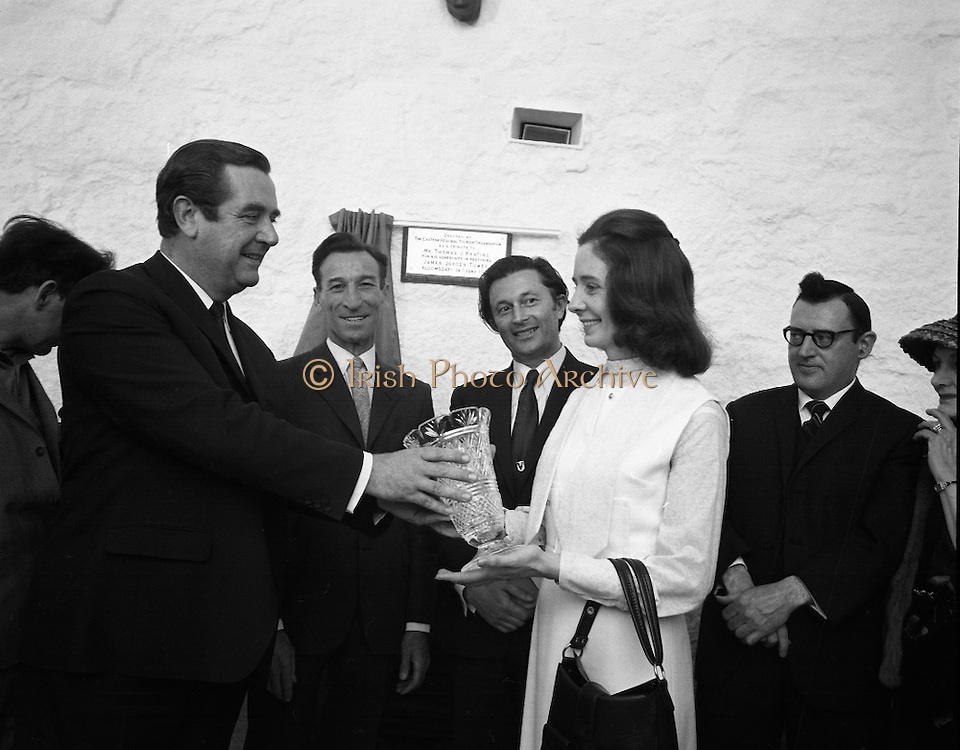 """Bloomsday at Joyce Tower,Sandycove..1972..16.06.1972..06.16.1972..16th June 1972..As part of the Bloomsday celebrations,Joyce Tower,Sandycove was renovated and opened to the public.The tower is an important part of the novel """"Ulysses"""" written by James Joyce.The celebration in part is organised by the Eastern Regional Tourism Organisation..Picture of Mr P.J.Power presenting a Waterford Crystal vase to Mrs Tom Keating.Mr Tom Keating and Mr P.J.Long are also in the picture."""
