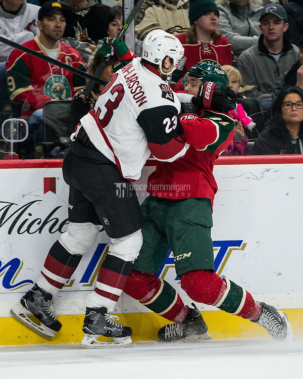 Dec 17, 2016; Saint Paul, MN, USA; Arizona Coyotes defenseman Oliver Ekman-Larsson (23) hits Minnesota Wild defenseman Matt Dumba (24) during the second period at Xcel Energy Center. Mandatory Credit: Brace Hemmelgarn-USA TODAY Sports