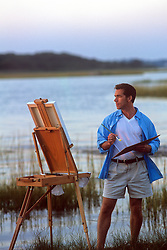 man painting by the bay in Southampton, NY