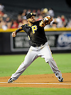 Sep. 20 2011; Phoenix, AZ, USA; Pittsburgh Pirates infielder Pedro Alvarez (24) makes the play at first base while playing against the Arizona Diamondbacks at Chase Field.  Mandatory Credit: Jennifer Stewart-US PRESSWIRE..