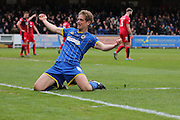 Paul Robinson defender for AFC Wimbledon (6) knee slides after his winning goal during the Sky Bet League 2 match between AFC Wimbledon and Crawley Town at the Cherry Red Records Stadium, Kingston, England on 16 April 2016. Photo by Stuart Butcher.