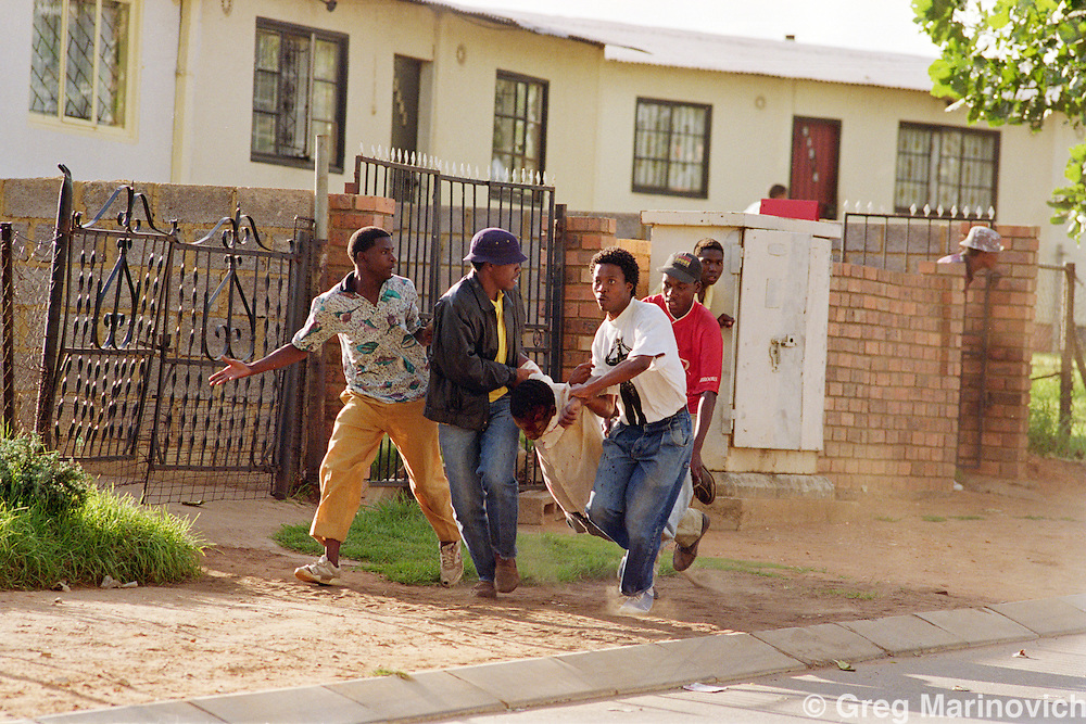 Meadowlands, Soweto, Johannesburg, South Africa.  ANC militant mortally wounded in clashes with IFP supporting hostel dwellers, Meadowlands, Soweto 26 April 1992