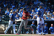 SURPRISE, AZ - MARCH 06:  A.J. Pollock #11 of the Arizona Diamondbacks scores  between Eric Stout #85 and Salvador Perez #13 of the Kansas City Royals in the fourth inning of the spring training game at Surprise Stadium on March 6, 2017 in Surprise, Arizona.  (Photo by Jennifer Stewart/Getty Images)