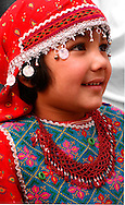 a young afghan girl watches the festivities, at a festival to celebrate the afghan new year, kabul.